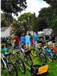 Several residents solved their automobile parking problem by cycling to the event