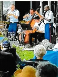 As in the past, the Band performed on high ground in front of the Garden shed.